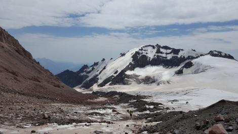 Reaching the white glacier. Kazbek summit expedition. Georgia, August 2016.