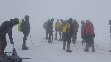 Climbers dropping their bags at the saddle.